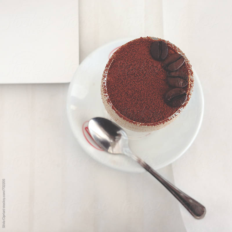 Coffee cream with cocoa powder and coffee beans on top by Silvia Cipriani for Stocksy United