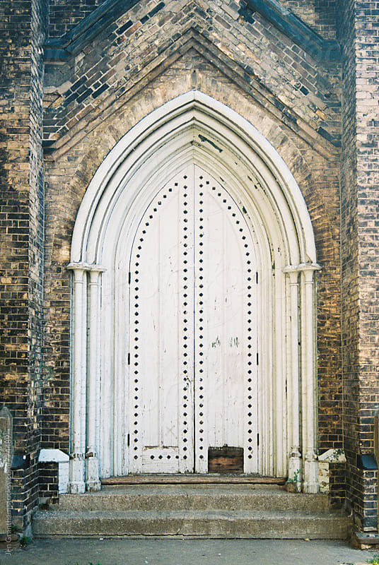 Old church door on expired film by Jen Grantham for Stocksy United
