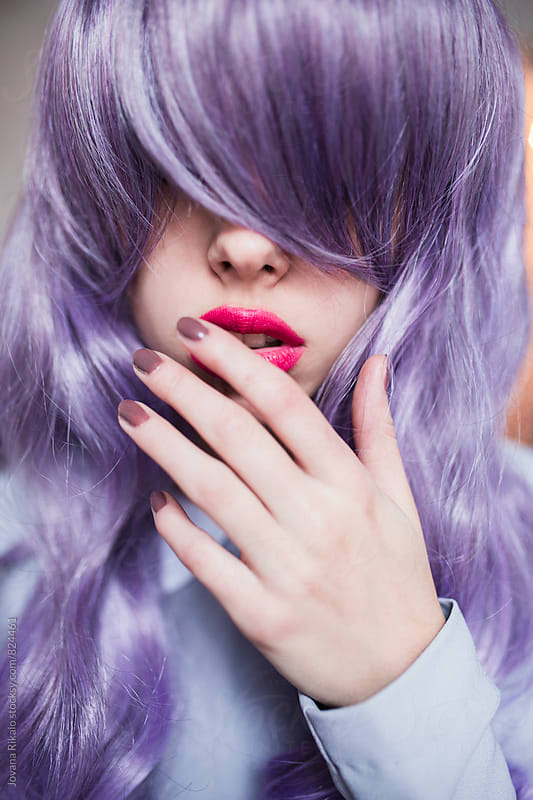 Portrait of a young woman with purple hair by Jovana Rikalo for Stocksy United