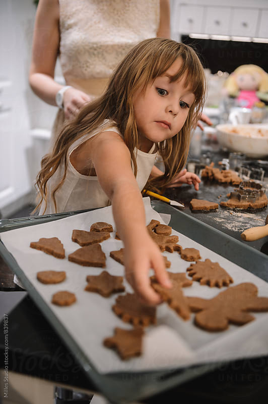 Mother and Daughter Baking Cookies by Milles Studio for Stocksy United