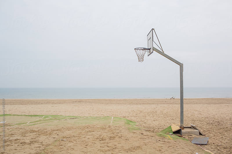 Basketball hoop along the beach by michela ravasio for Stocksy United