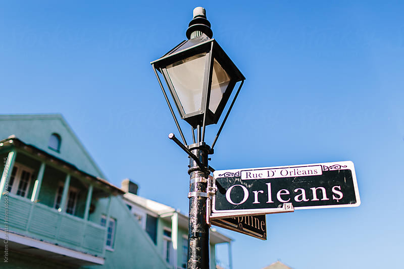 Orleans street sign in the French Quarter in New Orleans, Louisiana by Kristen Curette Hines for Stocksy United