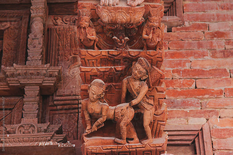 Erotic sensual wooden carvings of hindu gods and goddesses in a temple in Kathmandu, Nepal. by Shikhar Bhattarai for Stocksy United