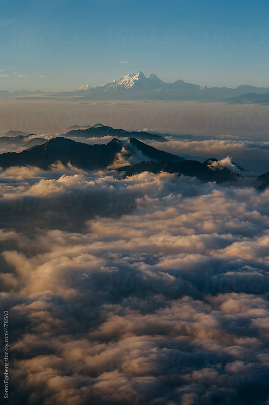 Aerial view of clouds and the Himalaya mountains from above. by Soren Egeberg for Stocksy United