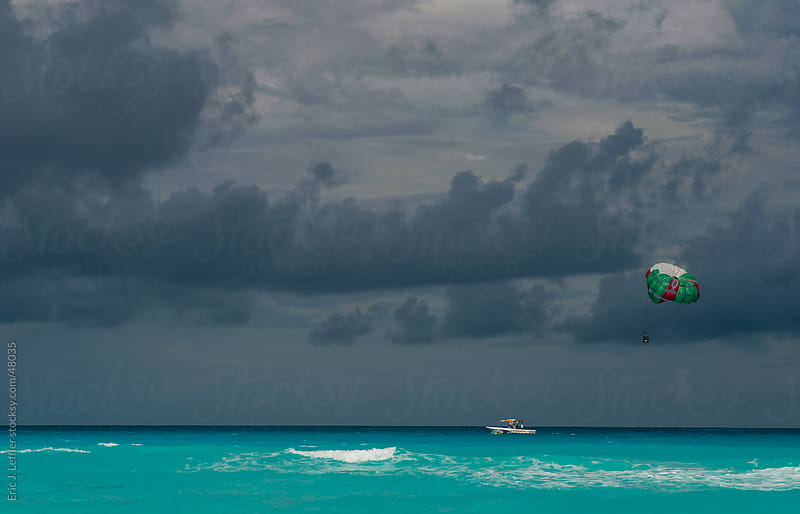 Parasailing in Cancun by Eric James Leffler for Stocksy United