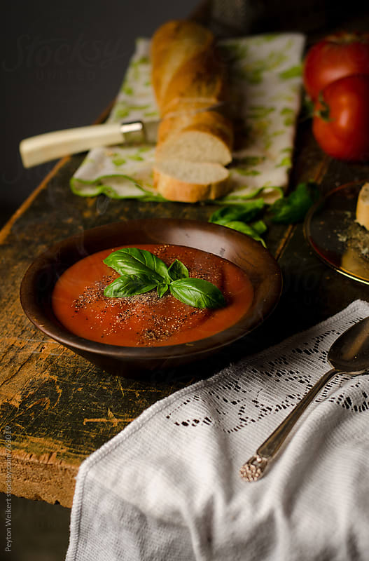 Hot Tomato Soup Served With Bread by Peyton Weikert for Stocksy United