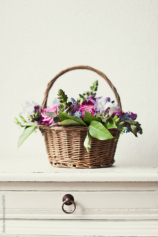 Basket of flowers by Zocky for Stocksy United