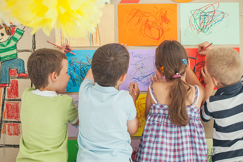 Preschoolers Drawing on the Wall by Lumina for Stocksy United