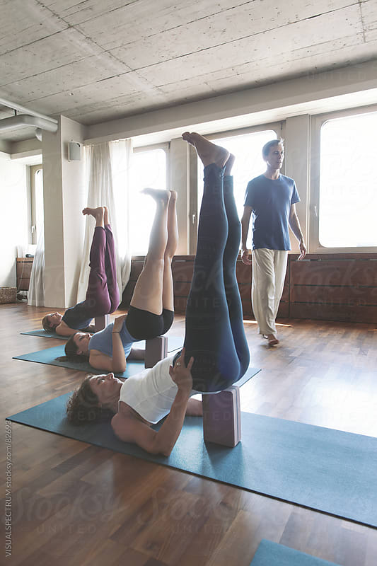 Yoga: Shoulderstand in Class by Julien L. Balmer for Stocksy United