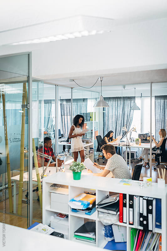 People in a Coworking Trendy Office by Victor Torres for Stocksy United