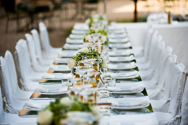 Table set for a wedding reception by Jean-Claude Manfredi for Stocksy United