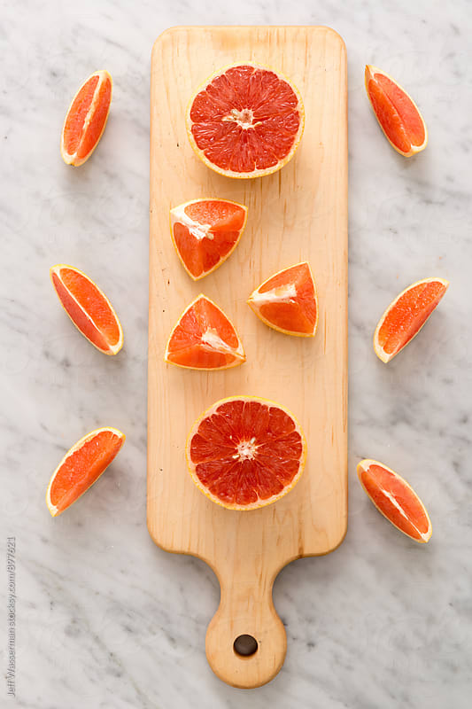 Grapfruit Pieces on Cutting Board by Jeff Wasserman for Stocksy United