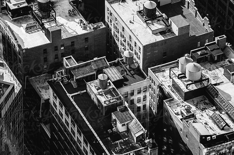 Overhead of a rooftops of buildings in Manhattan. by BONNINSTUDIO for Stocksy United