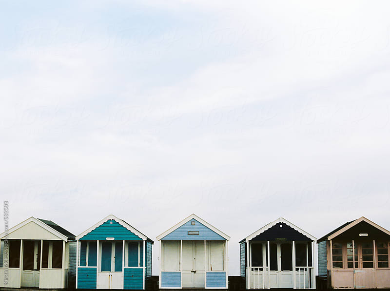 Row of beach huts in Southwold by Kirstin Mckee for Stocksy United