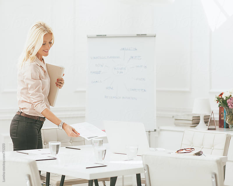 Businesswoman Arranging Documents in Her Office by Lumina for Stocksy United