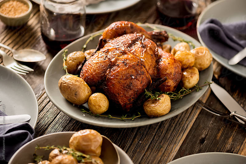 Rustic Roasted Chicken Dinner by Jeff Wasserman for Stocksy United