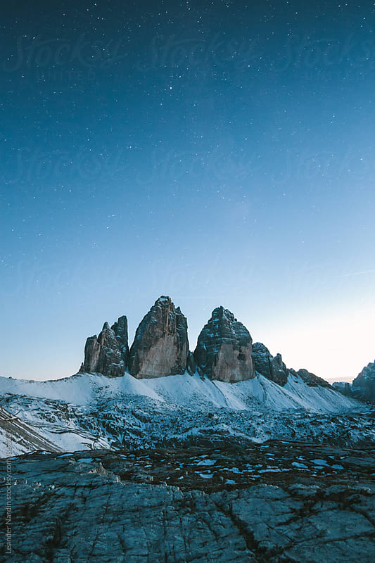 famous three pinnacles at the blue hour by Leander Nardin for Stocksy United
