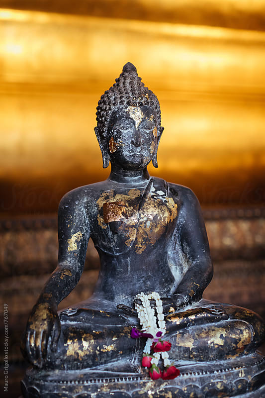 Statue inside a Temple in Thailand. by Mauro Grigollo for Stocksy United