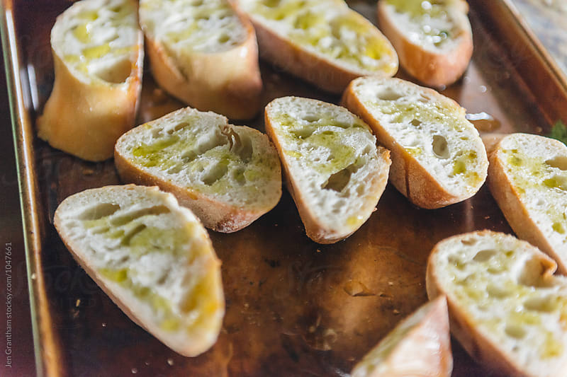Preparing garlic bread for grill by Jen Grantham for Stocksy United