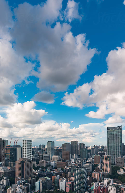 Clouds Over City Buildings by Leslie Taylor for Stocksy United
