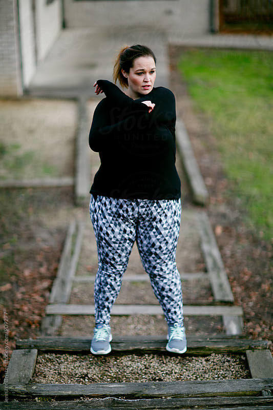 Woman working out by Jen Brister for Stocksy United