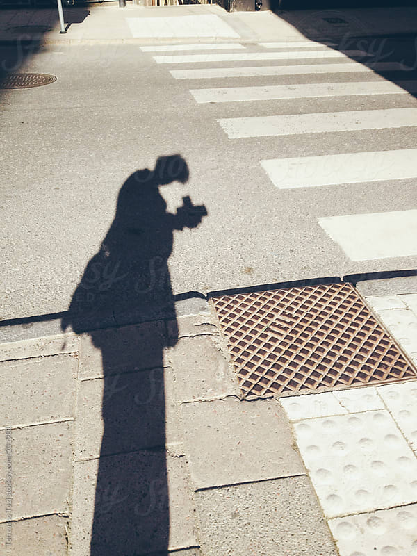 The shadow of a photographer by Tommaso Tuzj for Stocksy United