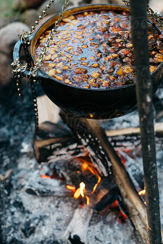 Traditional Hungarian Gulash in a kettle over a camp fire by Gabriel (Gabi) Bucataru for Stocksy United