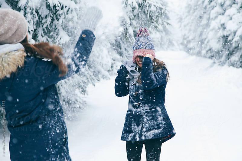 Joyful girlfriends having fun in the snow by Borislav Zhuykov for Stocksy United