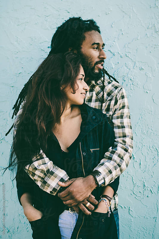 Young Relaxed Couple Looking Sideways by Stephen Morris for Stocksy United