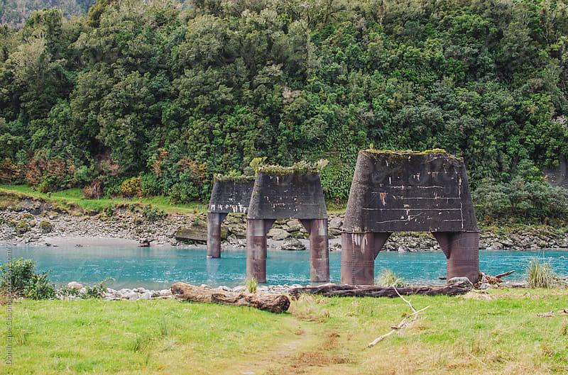 Broken bridge across clear blue waters by Dominique Chapman for Stocksy United