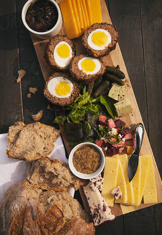 Variety Of Cheeses And Salads On British Ploughman's Plate by Sean Locke for Stocksy United