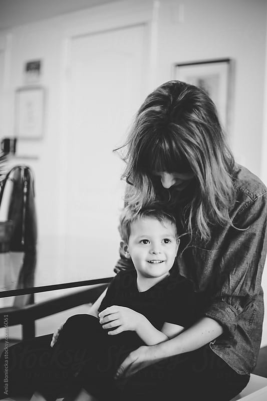 A mother and her son at a table by Ania Boniecka for Stocksy United