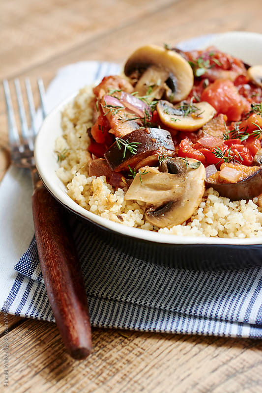 Eggplant, Mushroom Ragout on Couscous by Harald Walker for Stocksy United