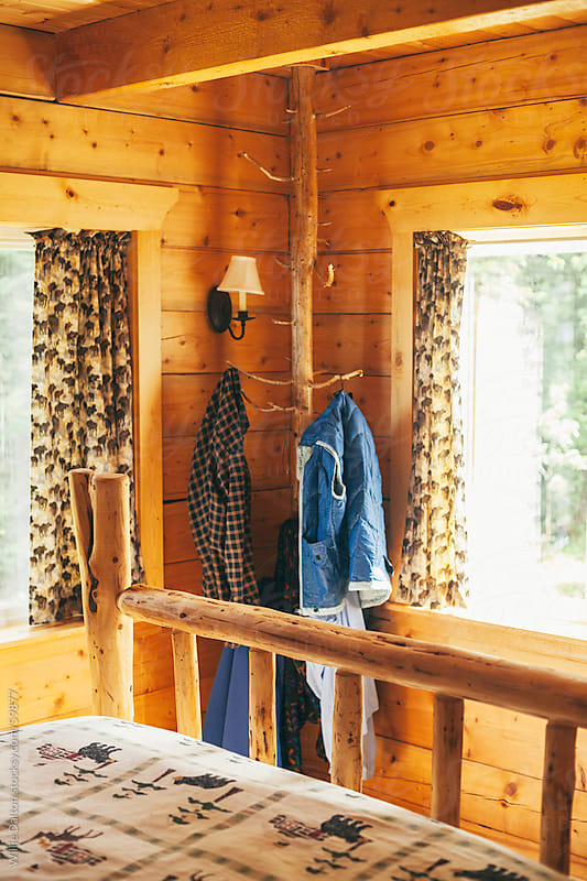 Log Coat Hanger in a Log Cabin Bed Room  by Willie Dalton for Stocksy United