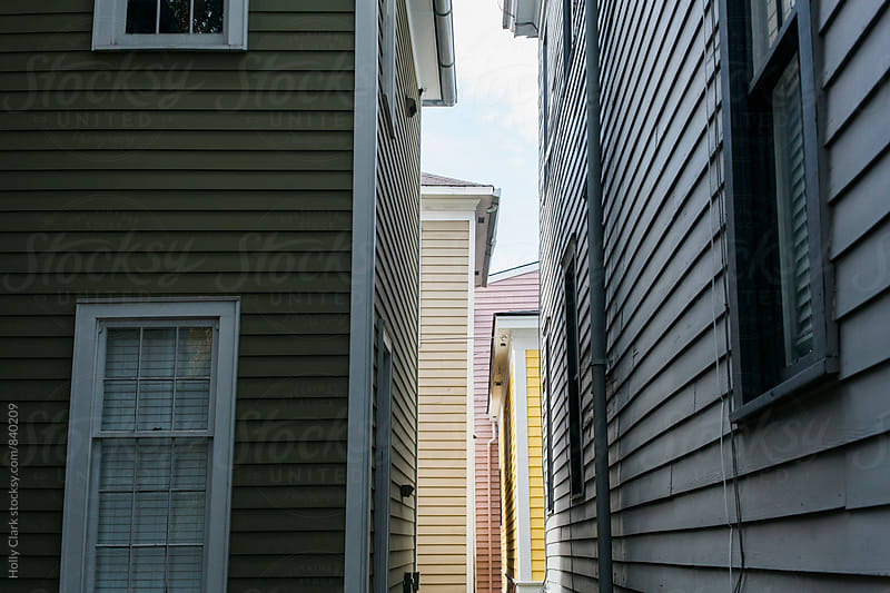 Crowded alleyway with colorful houses side-by-side. by Holly Clark for Stocksy United