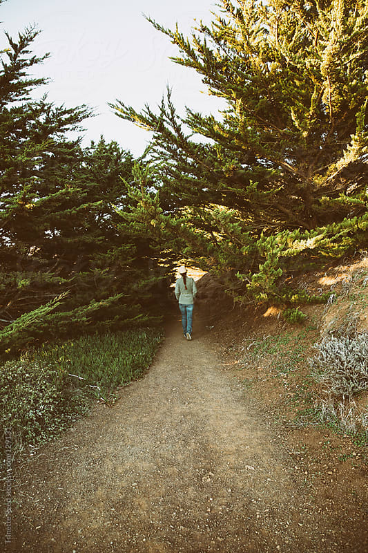 Woman hiking on pathway in nature by Trinette Reed for Stocksy United