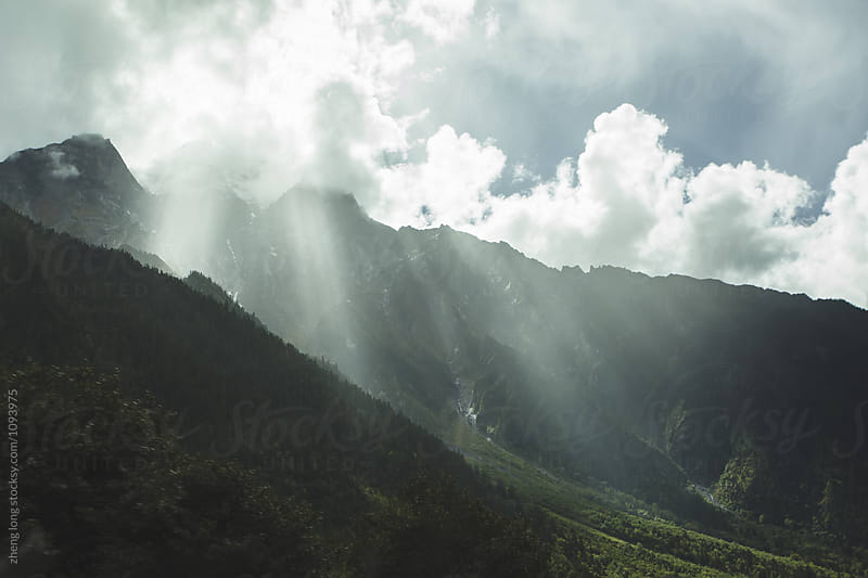 Sunlight through the clouds by zheng long for Stocksy United