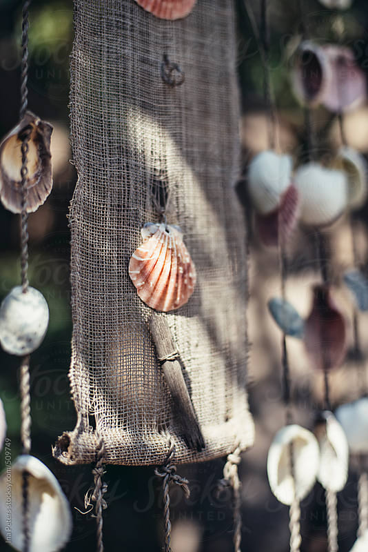 Objects: Homemade wind chime made of clams by Ina Peters for Stocksy United