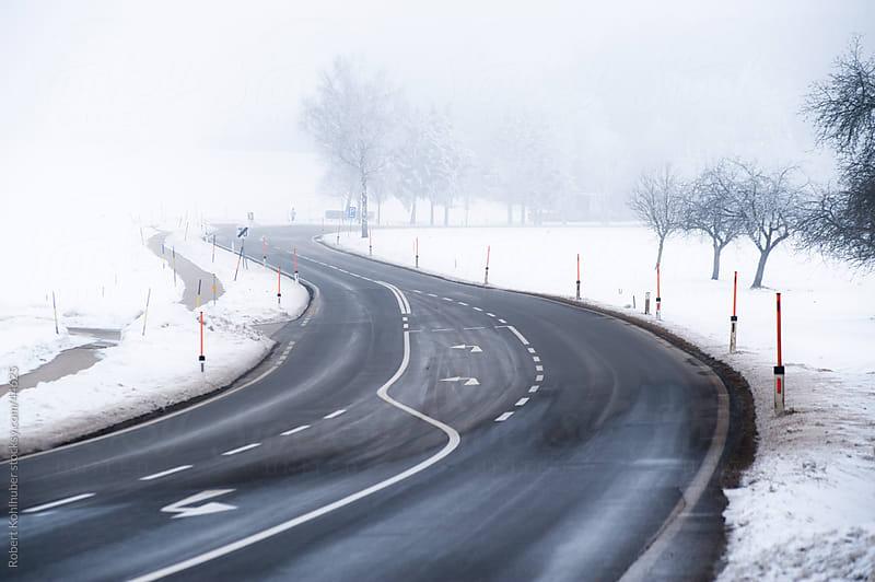 Street in winter landscape by Robert Kohlhuber for Stocksy United
