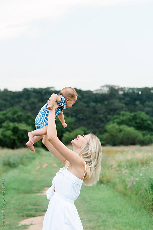 Mother with her baby by Kayla Snell for Stocksy United