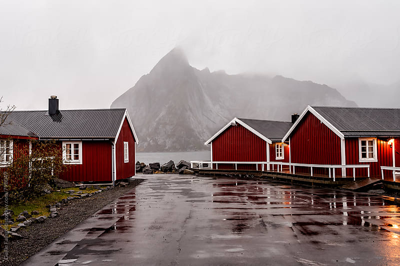 lofoten. Winter time. Three red houses by Guille Faingold for Stocksy United