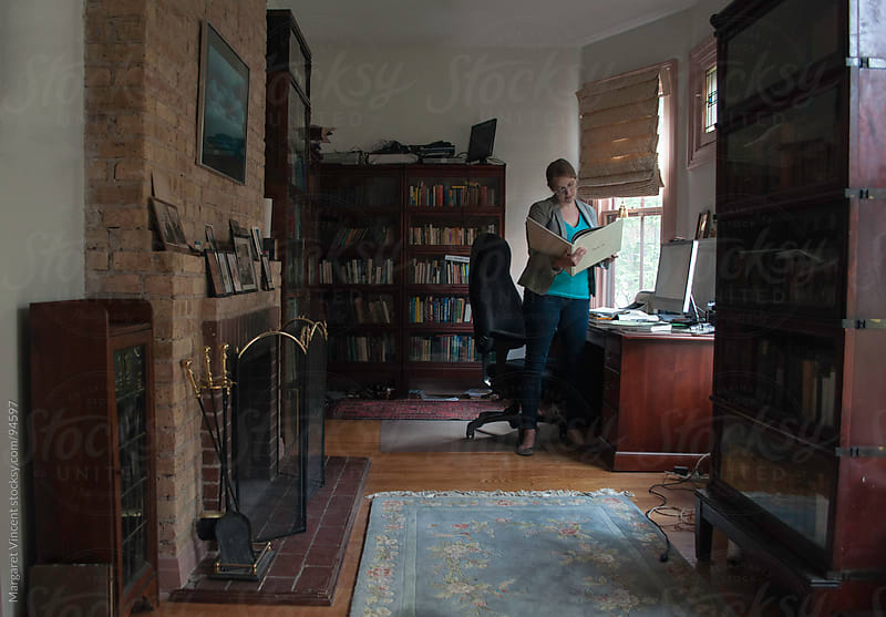 woman works in home office by Margaret Vincent for Stocksy United