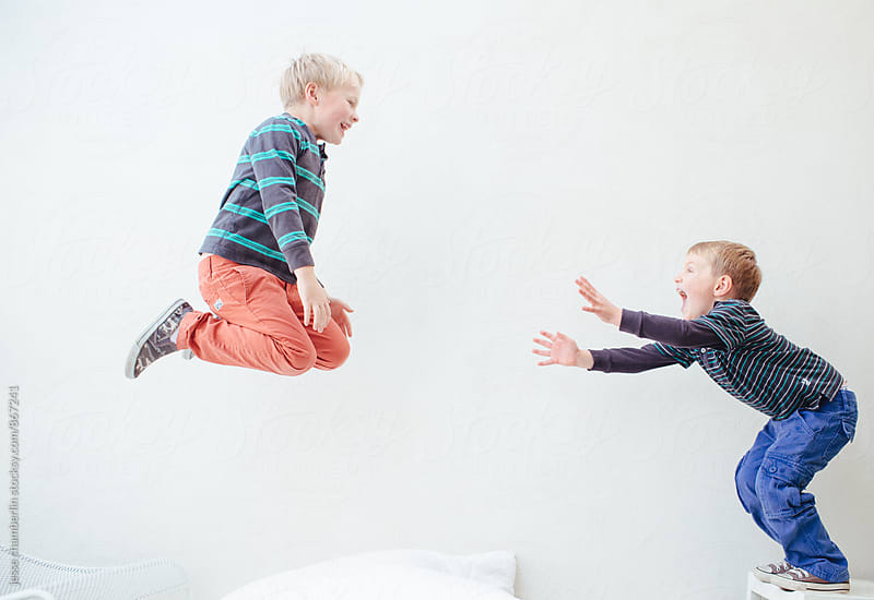 Brothers Jump Together by jesse chamberlin for Stocksy United