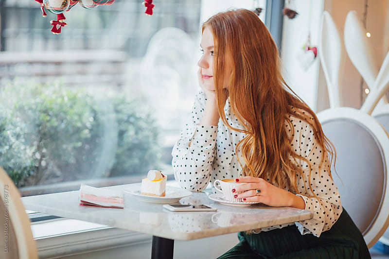 Elegant Woman Drinking Espresso at a Café by Lumina for Stocksy United