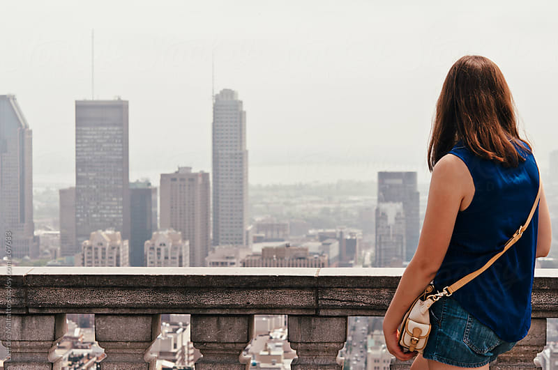 teen girl looking out over city by Deirdre Malfatto for Stocksy United