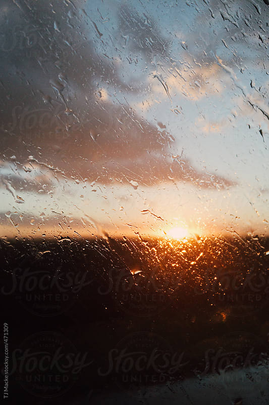 Sunset through the passenger window by TJ Macke for Stocksy United