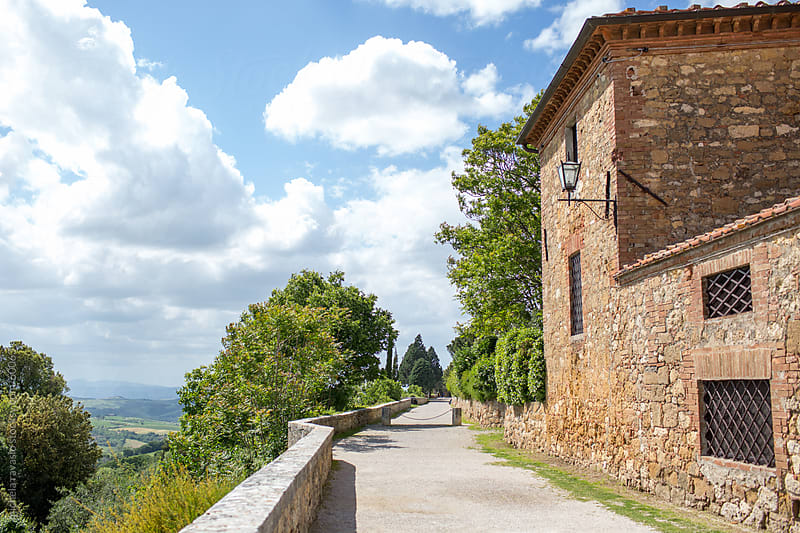 Pedestrian street in the hills of Tuscany by michela ravasio for Stocksy United