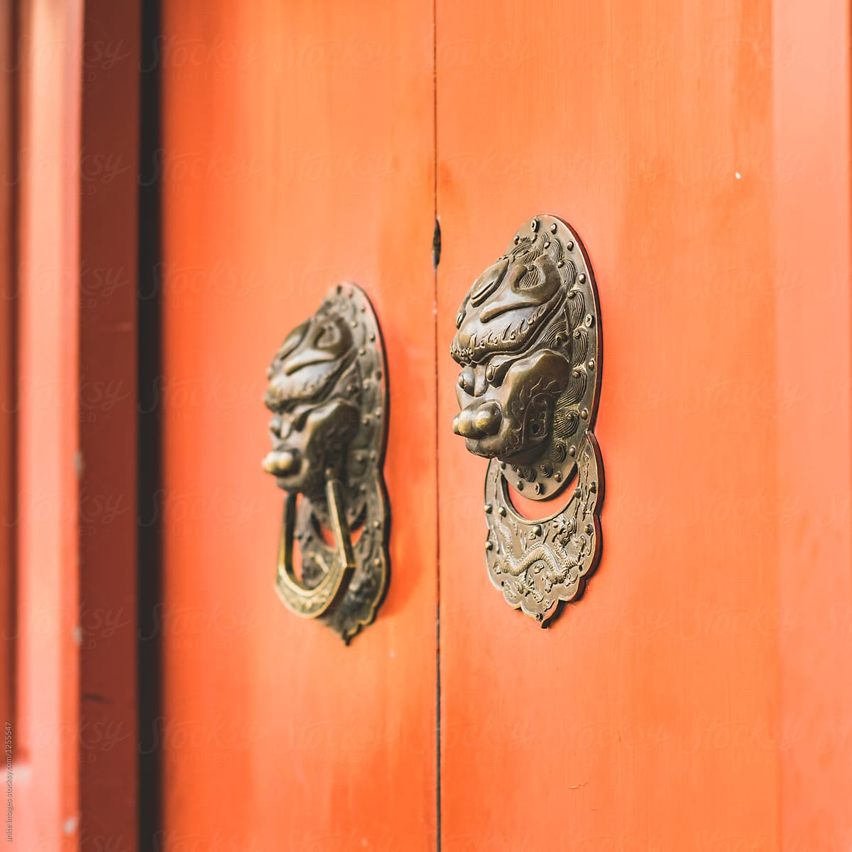 Close Up Of Ancient Gold Handle Knocker On Red Door In Chinese