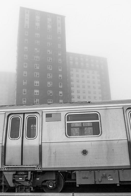 New York City subway train against the backdrop of apartment buildings by Mihael Blikshteyn for Stocksy United