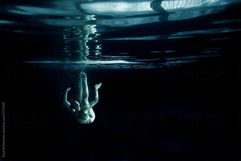 Synchronized swimmer by Paul Schlemmer for Stocksy United